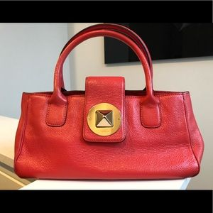 Kate Spade handbag in hot coral